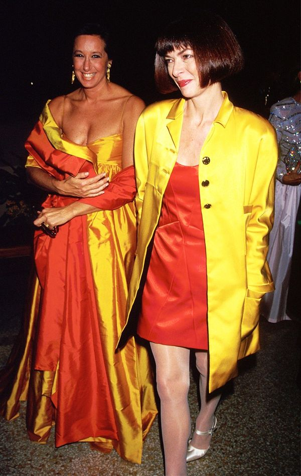 Anna Wintour in the '90s wearing (and standing alongside) designer Donna Karan.