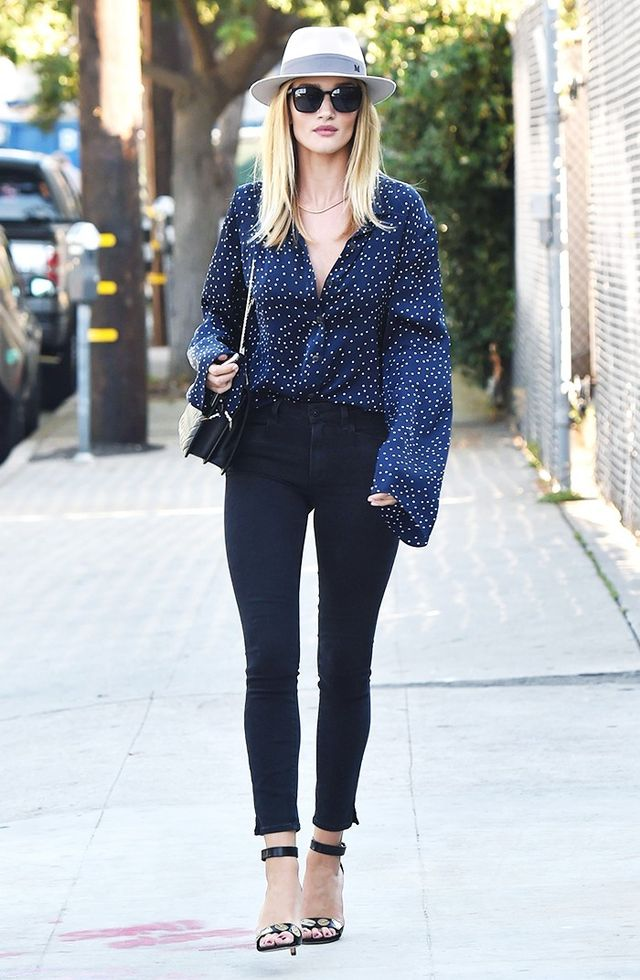 On Rosie Huntington-Whiteley: Maison Michel Andre Fedora ($650); Magda Butrym Orleans Shirt ($660); Paige Roxxi Ankle Jeans With Slits ($195); Céline shoes.