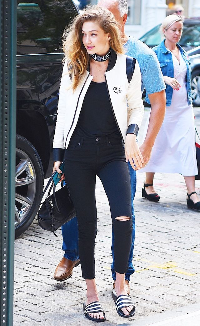 On Gigi Hadid: Adidas Originals Adilette Pool Slides ($30); The Mighty Company Provence Jacket ($795); 7 for All Mankind B(air) Skinny Jeans ($189); Versace collar necklace.