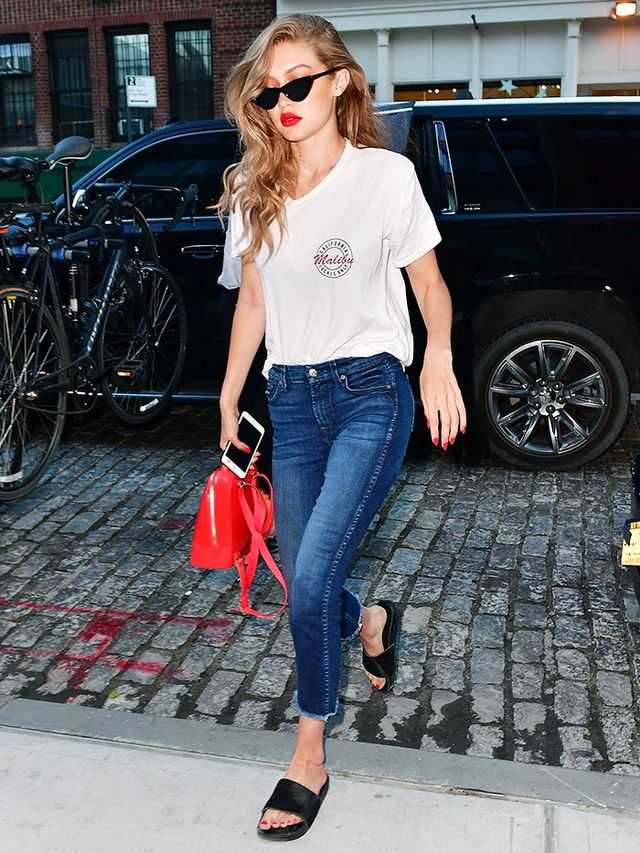 On Gigi Hadid: Brandy Melville T-shirt; 7 For All Mankind The Ankle Skinny Jeans (£157); Adam Selman x Le Specs sunglasses; Furla bag; Adidas Adilette Premium Slides...