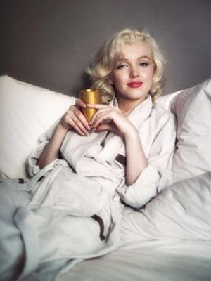 Marilyn monroe celebrity fashion news and style whowhatwear see rare footage of marilyn monroe looking so in love on her wedding day voltagebd Gallery