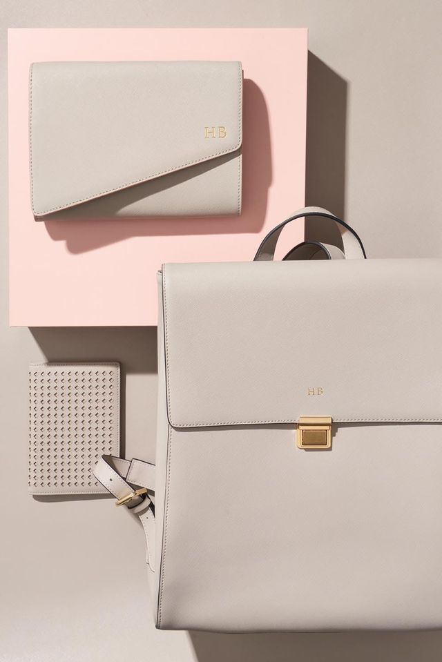 Pictured: The Daily Edited Asymmetric Clutch With Pale Pink Edge($160), The Daily Edited Large Backpack($330), The Daily Edited Perforated Passport Holder($80).