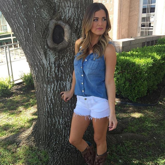 On JoJo Fletcher: Bebe Denim Sleeveless Shirt ($79); Blank NYC jeans and cowboy boots.