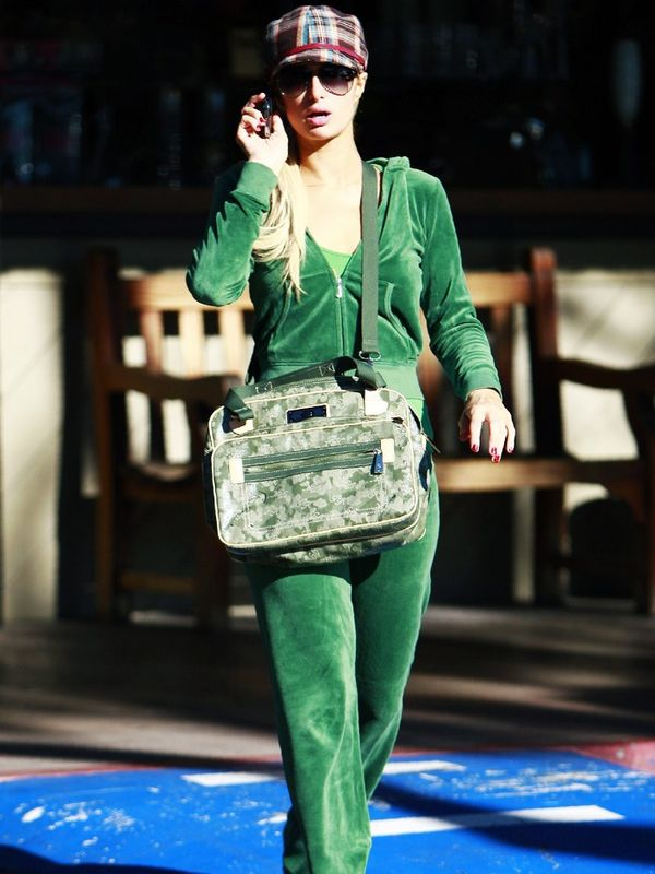 2000s fashion: Paris Hilton wearing a green Juicy Couture velour tracksuit and trucker hat