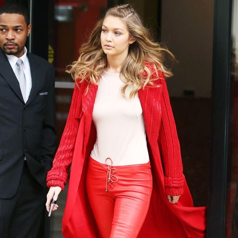 2000s fashion: Gigi Hadid wears red leather lace up trousers