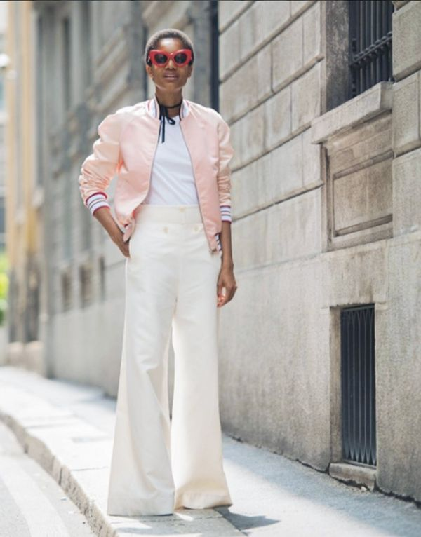 Style Notes: How to make that pink bomber jacket look totally cool? Pair with wide-leg pants and some sunglasses.