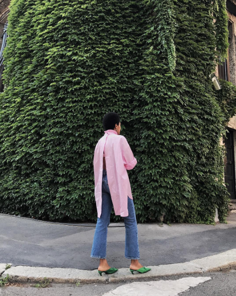 Style Notes: This is colour clashing at its finest. Choose between those emerald-green Balenciaga mules (yes, please) or the oversize pink shirt—either will look impossibly chic when worn...