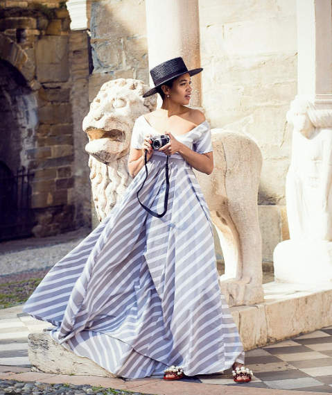 Style Notes: A statement sundress is always a must. How to add a new-season edge? This look tells us that a wide-brim hat and embellished slides will do the job nicely.