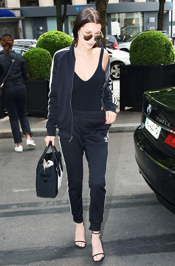 Elevate an Adidas tracksuit by swapping the T-shirt and sneakers for flattering single-sole two-strap heels and a tight-fitting bodysuit.  