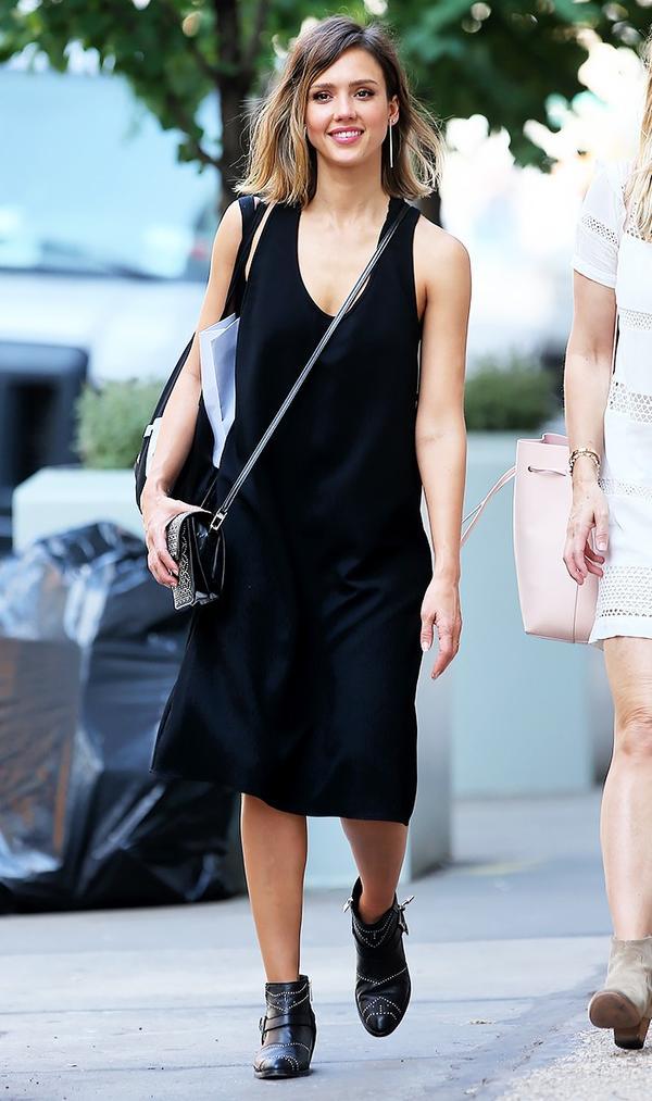 On Jessica Alba:Alaïa Double Pocket Small Embellished Leather Shoulder Bag($2890);Anine Bing Bianca Boots($700).