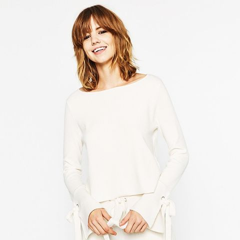 Sweater With Sleeve Slits