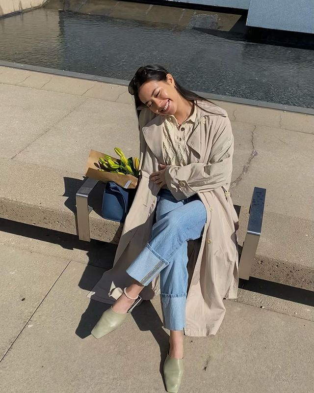 Best Flat Shoes: @sasha.mei wears a pair of sage square-toe flat shoes with jeans and a trench coat