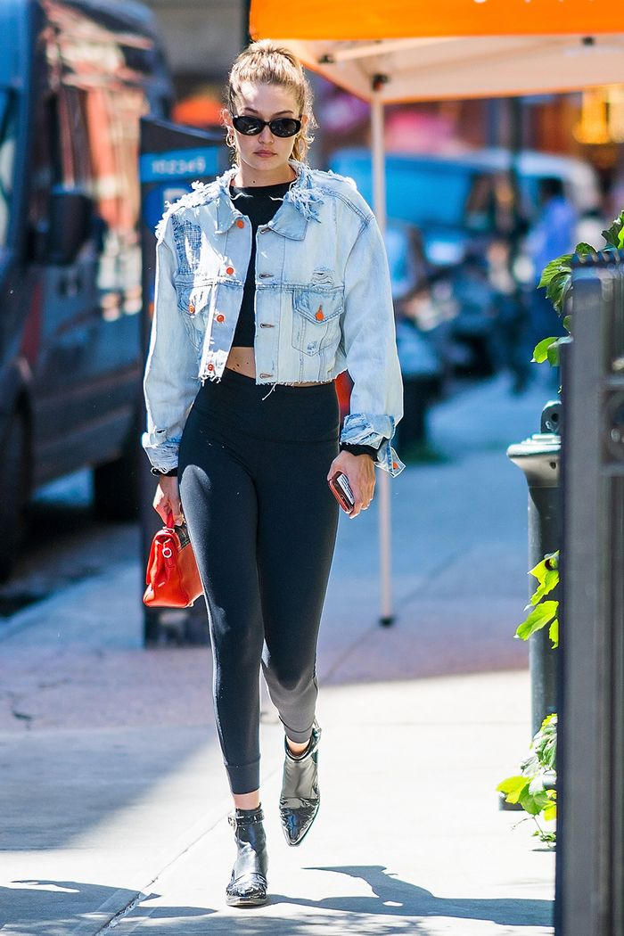 Treggings: Gigi Hadid wearing thick black leggings with a denim jacket and ankle boots