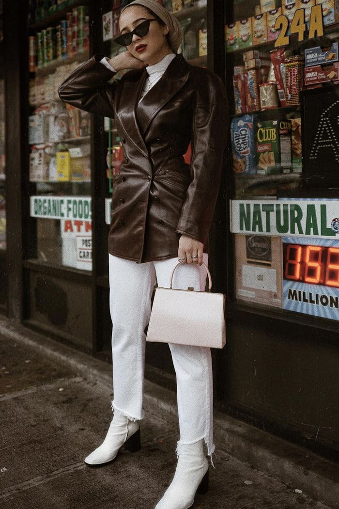 best leather jackets: Maria Alia in a double-breasted leather jacket by Azzedina Alaia and white jeans