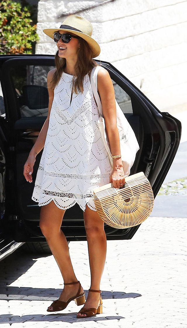 On Jessica Alba: Cult Gaia Gaias Ark Bag ($88); Lovers + Friends Under the Sun Dress ($210); Louise et Cie Genna Sandal ($129).