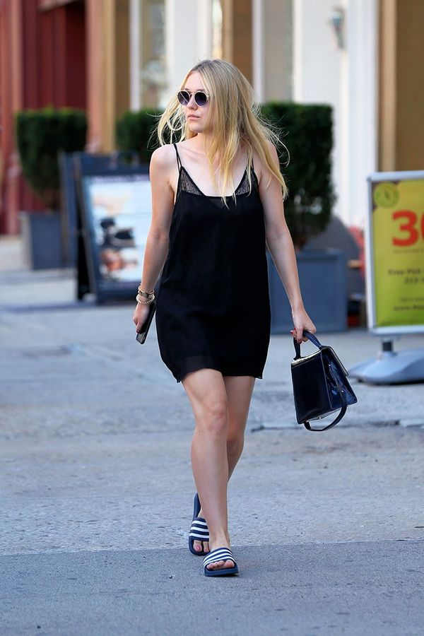 On Dakota Fanning: Adidas Adilette Slides ($30).
