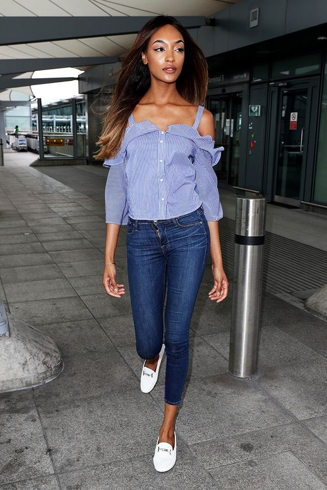 On Jourdan Dunn: Frame jeans; Tod's Gommino Driving Shoes ($725). Shop similar: Sandy Liang Hammond Top ($395); Frame Le Skinny de Jeanne Crop Mid-Rise...