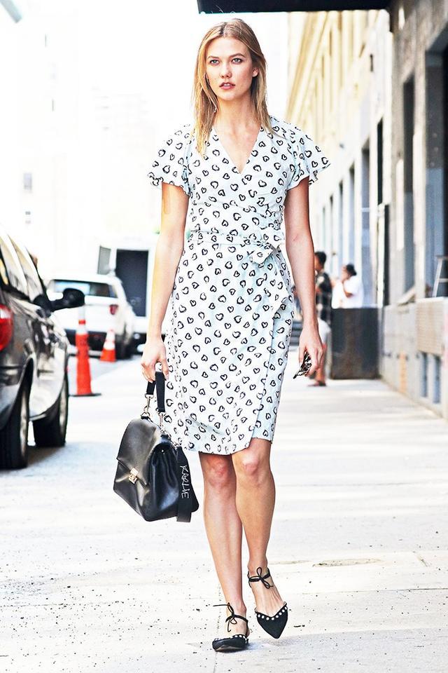 On Karlie Kloss: Warby Parker Downing Sunglasses ($95); Vanessa Seward Bagatelle Dress ($955) ($478); Carolina Herrera Baret Bag (price upon request); Bionda Castana Leah Flats($629) ($248).