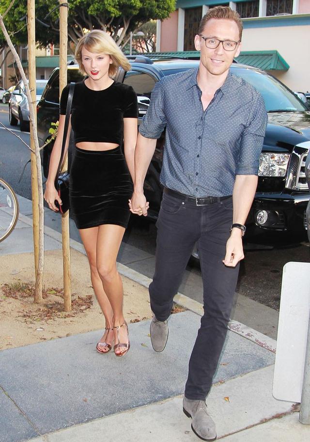 On Taylor Swift: Nicholas KirkwoodCasati Embellished Metallic Patent-Leather Sandals($695);EtroF/W 16 handbag.