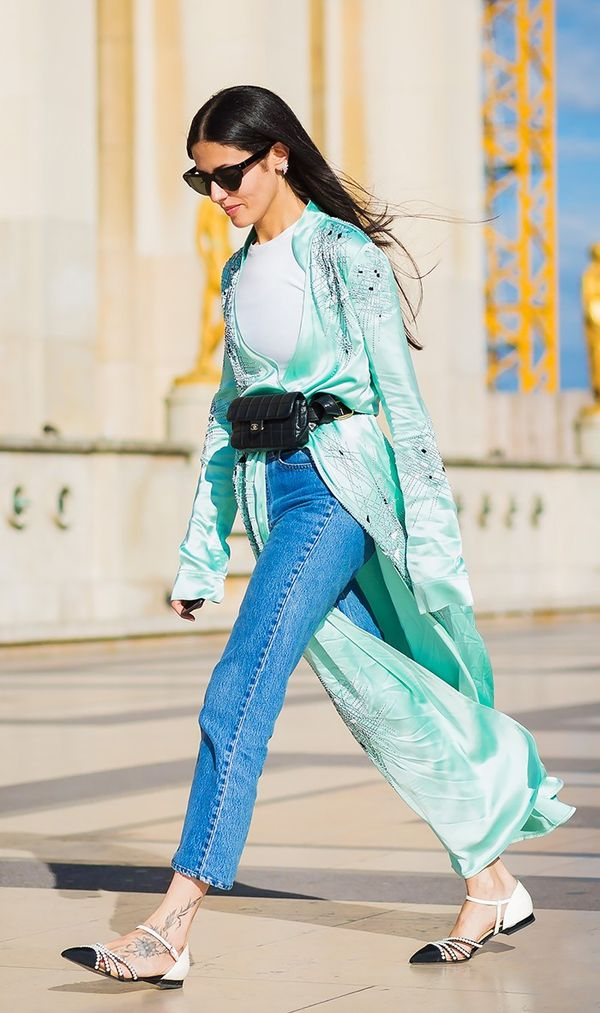 Attico designer Gilda Ambrosio wears a belt bag over her long jacket.