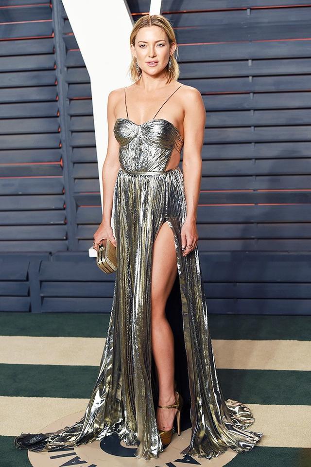 On Kate Hudson: Maria Lucia Hohan Norina Metallic Pleated Chiffon Gown in Gold ($3895).
