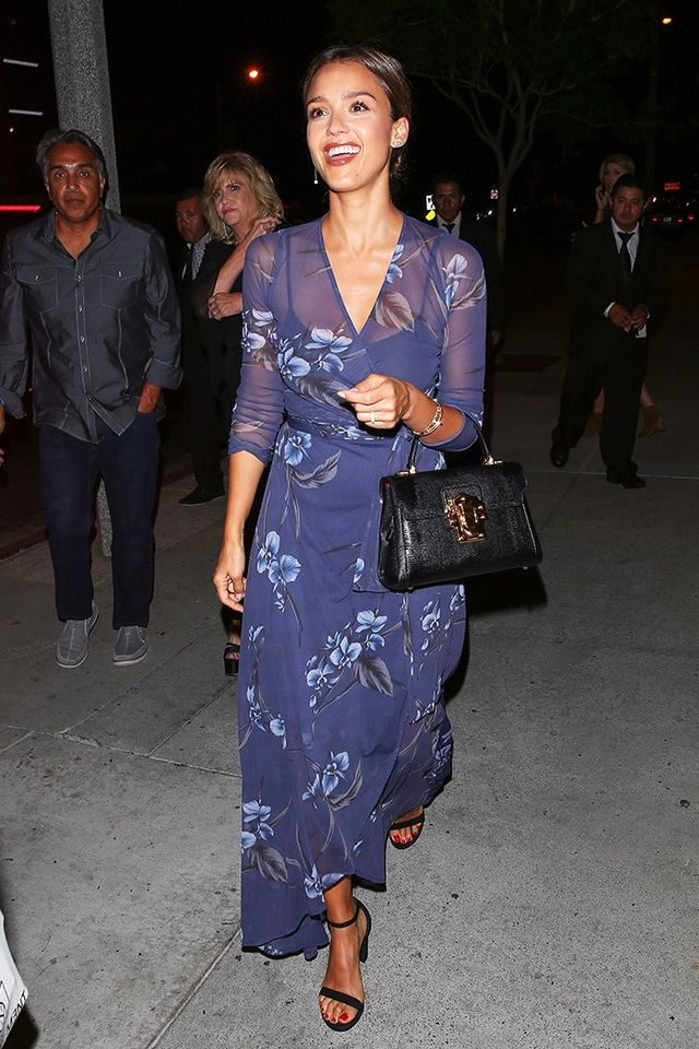 On Jessica Alba: Ganni Etsu Mesh Dress ($272); Stuart Weitzman NearlyNude Sandals ($400).