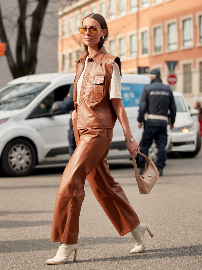 best ankle boots: street styler wearing a pair of brown rubber rain boots