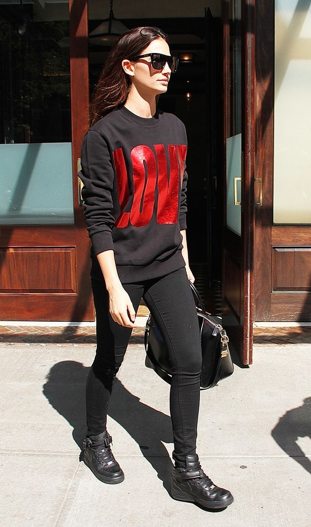 On Lily Aldridge:GivenchySunglasses($295),Medium Antigona Bag($2435),andMetallic Printed Sweatshirt($1350);PaigeTranscend Margot Skinny...