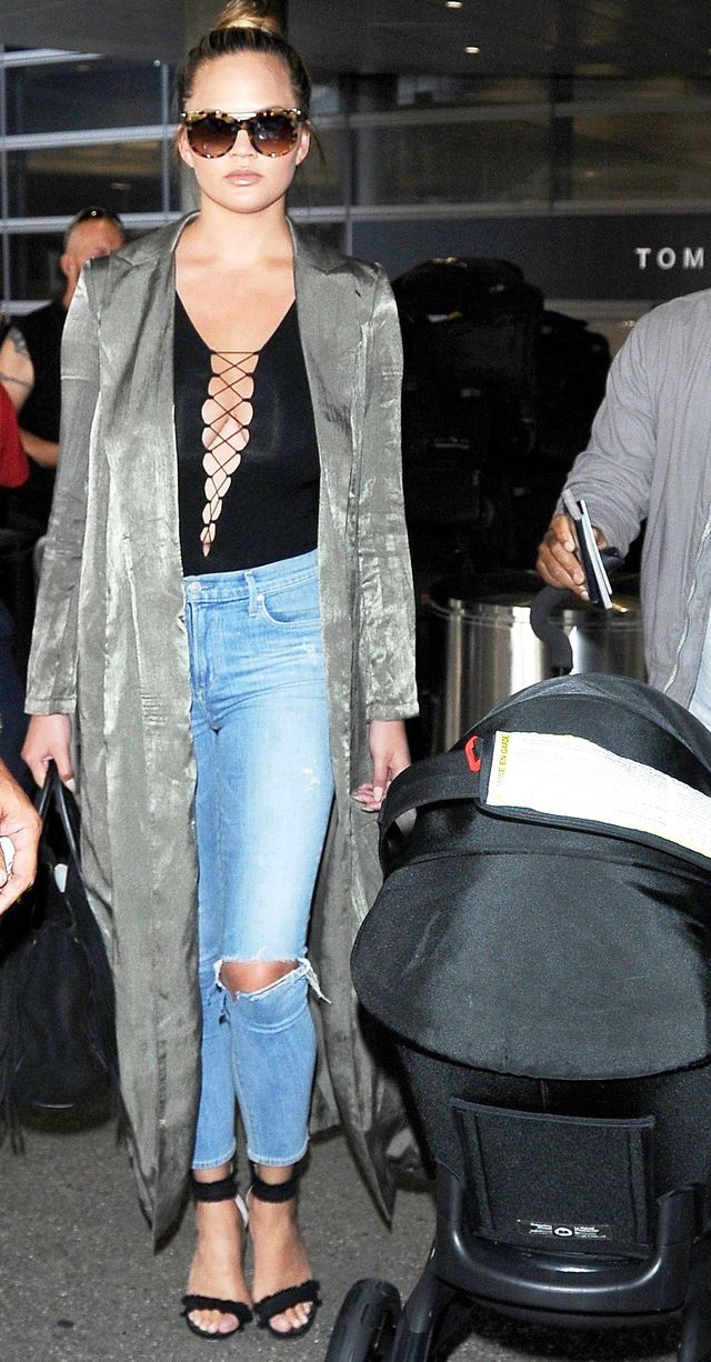 On Chrissy Teigen: Alexander McQueen Piercing Bar Sunglasses ($375); Naked Wardrobe The Uptown Duster ($48); T by Alexander Wang Lace-Up Jersey...