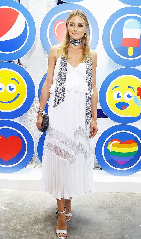 Palermo made a white dress feel fresh by adding a printed skinny scarf. On Olivia Palermo: Paige Skinny Scarf in Santina Paisley ($58); Self-Portrait Amelia Pleated Lace Dress ($495); Nathalie...
