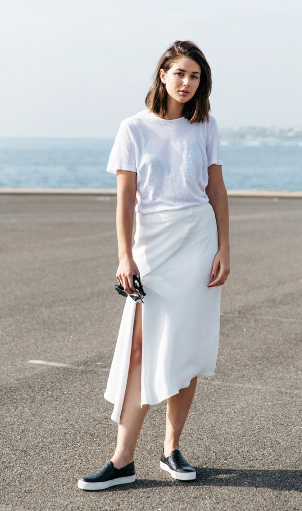 Style Tip:Contrast a white-on-white ensemble with black slip-on sneakers.