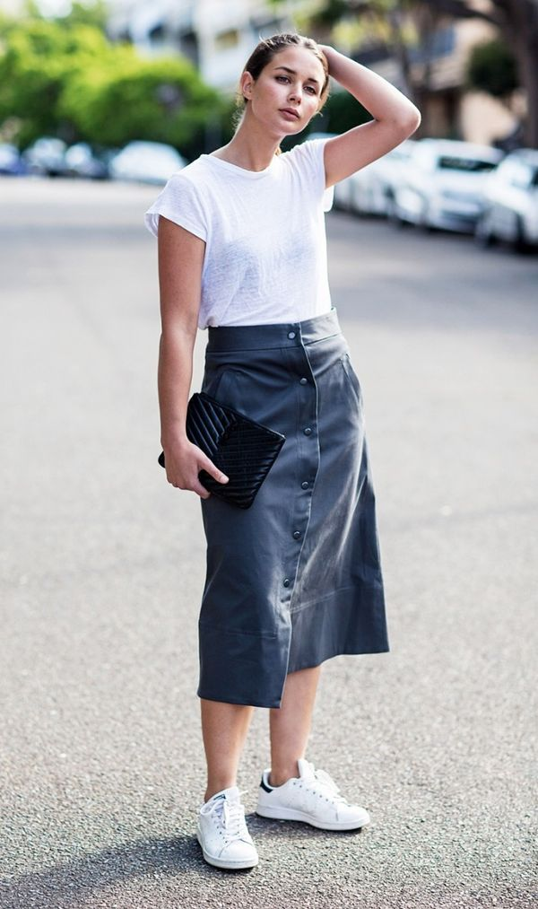 Style Tip:Tone down a statement leather skirt with casual separates like a white tee and sneakers.