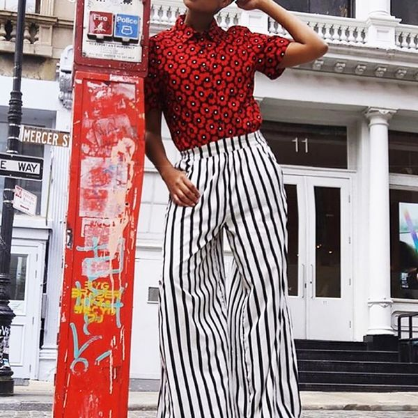Style Tip: Contrast your striped trousers with a floral-print blouse.