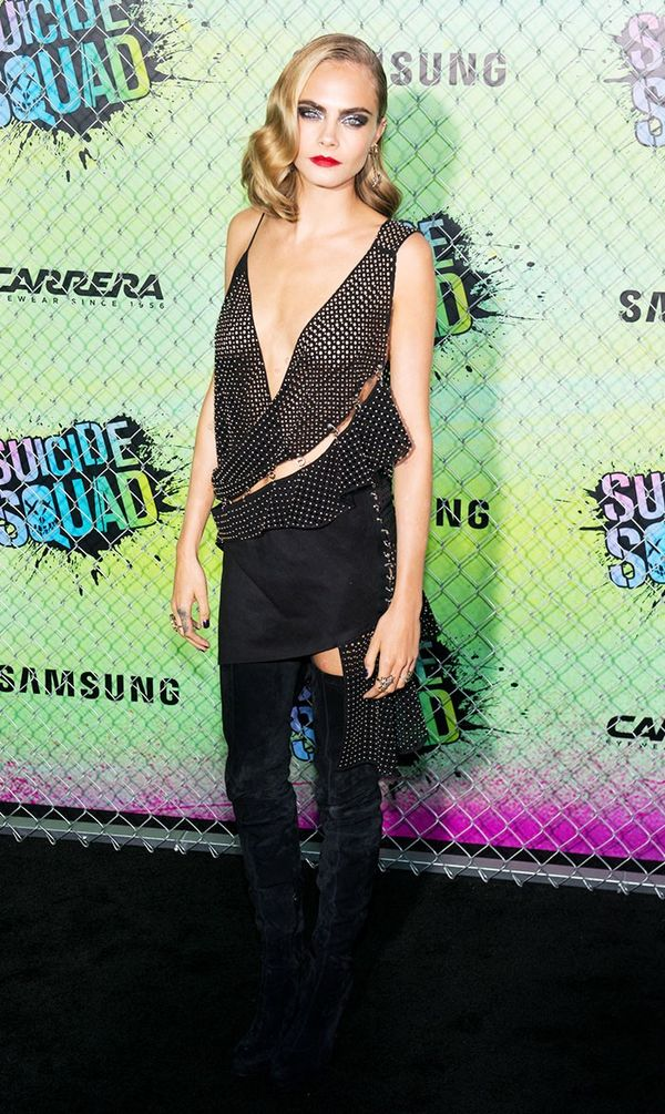 On Cara Delevingne: Anthony Vaccarello dress; Christian Louboutin boots.