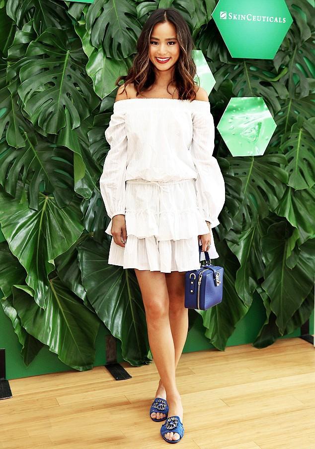 On Jamie Chung: Elizabeth and James Kenji Cotton Off-the-Shoulder Dress ($365) ($146); Dolce & Gabbana Rosaria Tote ($2395) and Bianca Crystal-Embellished Lace Slides ($795).