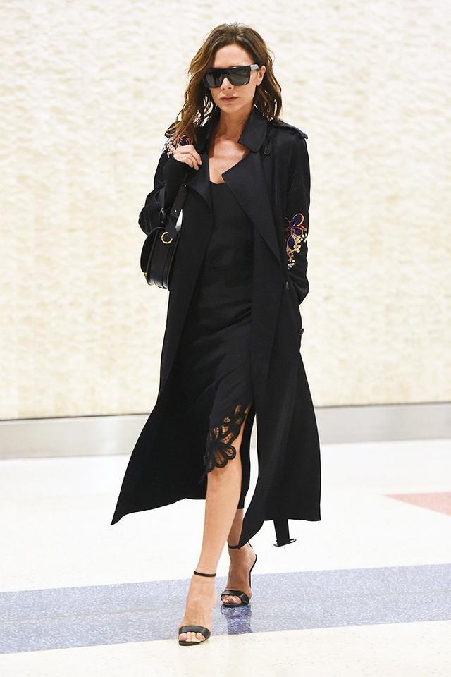 On Victoria Beckham:Victoria BeckhamD-Frame Acetate Sunglasses($450),Half Moon Leather Shoulder Bag($2500), andEmbroidered Hem Cami...