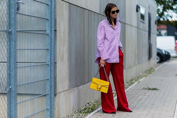 Style Notes:Darja Baranik's loose-fit Gannishirt, jumbo red trousers and yellow Guccibag make us want to a) supersize everything we own and b) start colour blocking more...