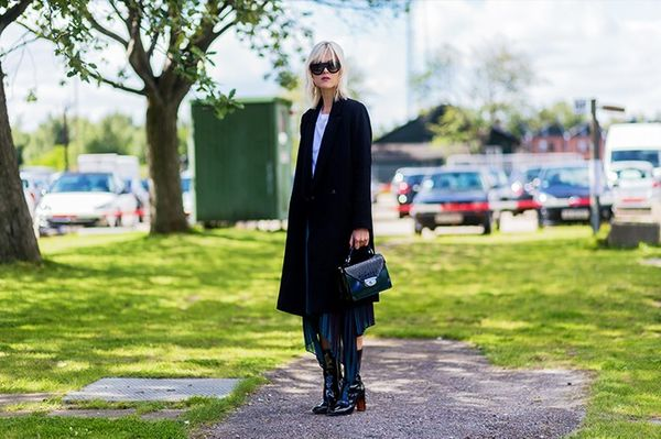 Style Notes:Linda Tol's accessories make this outfit sing. We want the Diorsock-boots very, very much.