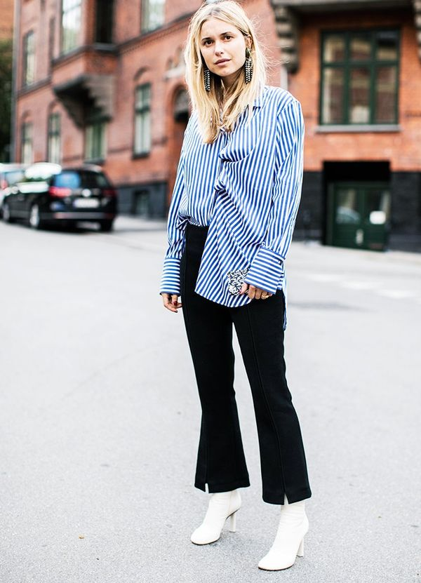 Style Notes: Pernille Teisbaek punctuates a relatively simple ensemble—a blue striped shirt and black trousers from By Malene Birger—with dazzling earrings from the same Danish label...