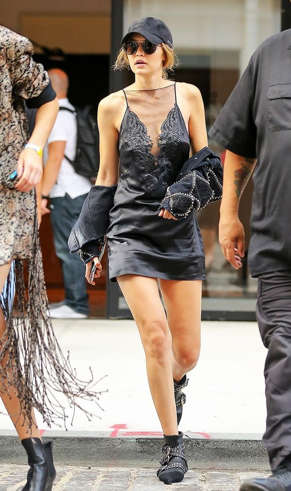 On Gigi Hadid: Jitrios Jourdan Dress ($2189); Isabel Marant boots.