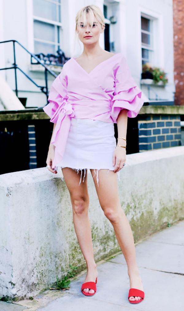 On Pandora Sykes: Storets Vivian Ruched Sleeve Top ($68); Vintage skirt; Mansur Gavriel Suede 40MM Single Strap Sandal in Flamma ($425).