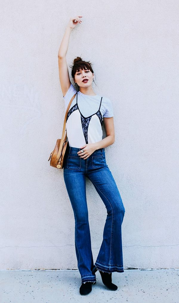 On Natalie Suarez: Express Crew Neck Tee and Lace Inset Cami ($60) and Mid Rise Released Hem Bell Flare Jeans ($48).
