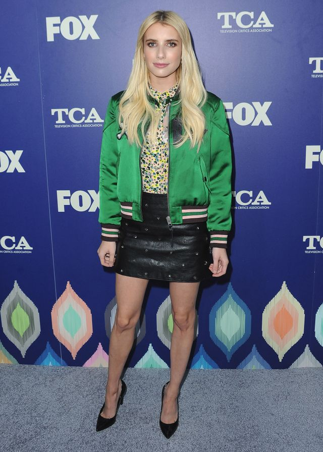 On Emma Roberts: Loren Stewart Safety Pin Earrings ($255); Coach top and Star Stud Leather Mini Skirt ($895); Saint Laurent Paris Pump ($595). Similar Style: Topshop Reversible Sateen Bomber...