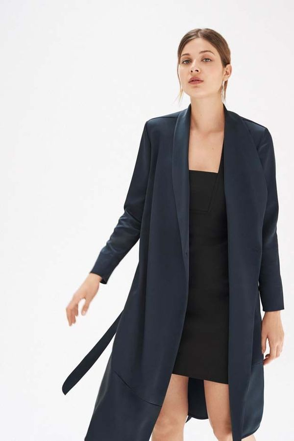 An open robe coatstyled with a simple slip dress is enduringly romantic.