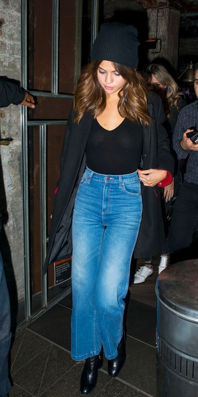 On Selena Gomez: White+Warren Cashmere Plush Rib Beanie ($130); Aqua Halter Rib Bodysuit ($48); Wrangler Marfa High-Rise Cropped Flare Jean ( $119 ) ($70); Dear Frances Spirit Boots...