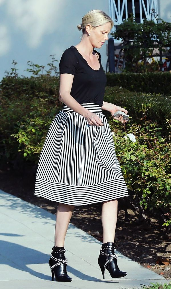 On Charlize Theron: Forever 21 skirt.
