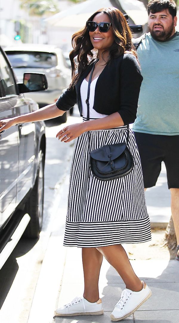 On Gabrielle Union: Forever 21 skirt and crossbody bag; Soludos Platform Tennis Sneakers ($159).