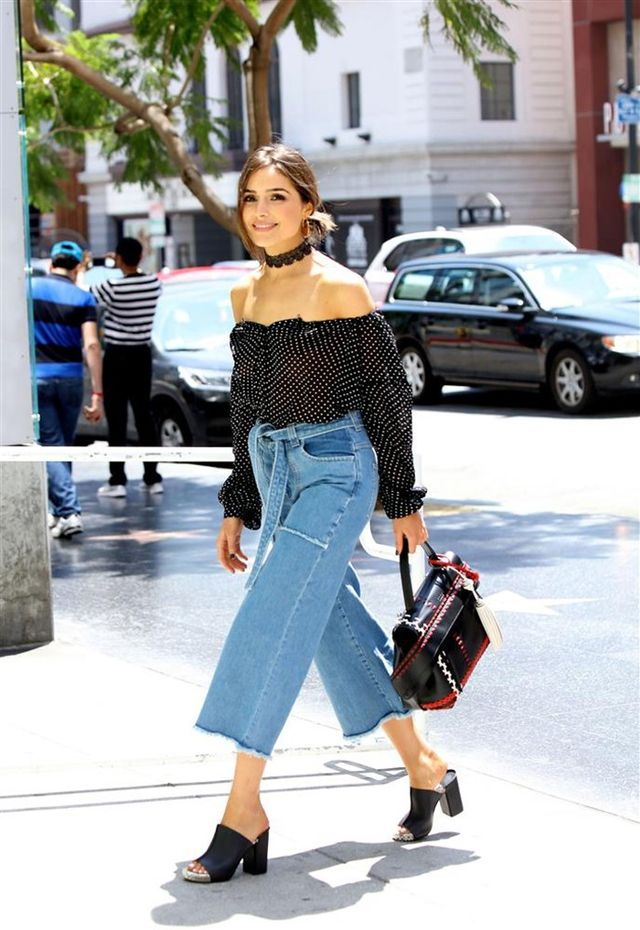 On Olivia Culpo: Victoria Beckham Culotte Jeans ($364); Fallon Andalusia Lace Choker ($98); Tod's bag; Calvin Rucker FWRD Exclusive Truth Is Top ($225); Robert Clergerie Amina Mules ($292).