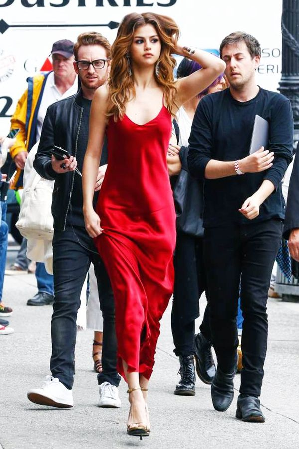 On Selena Gomez: Nili Lotan Spanish Red Silk Cami Gown ($595); Saint Laurent Metallic Leather Jane Sandals ($695).