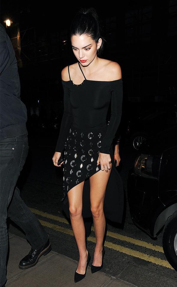 kendall jenner wearing black bodysuit and skirt
